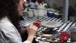pottery art - artist woman draw on pottery porcelain