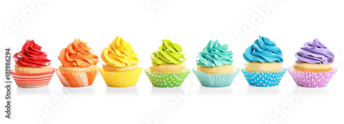 Photo  Tasty colorful cupcakes on white background