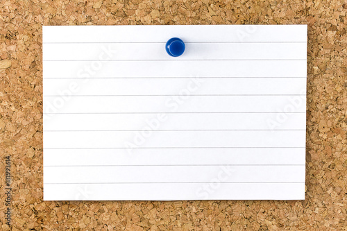 Fotografie, Obraz  Horizontal Blank white striped sheet fixed on cork board with a blue small thumb
