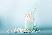 Milk  Shake With Marshmallows  In A Glass Jar On A Blue Background