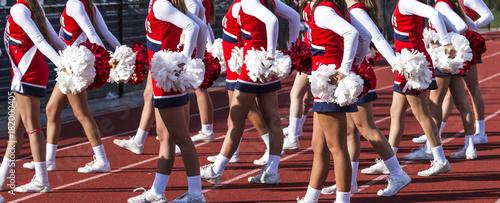 Fotografía High school cheerladers during a football game
