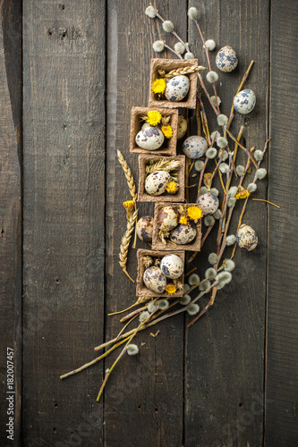 Foto op Plexiglas Chicago Spring Easter basket with eggs of different sizes, spring flowers, cereals, willow branches. on a wooden dark background decorated with wheat and flowers. Place for text. Flat lay, top view