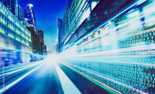 City street with binary code numbers on motion blurred asphalt  road , speed and faster digital matrix technology information concept Fototapet