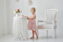Cute Little Girl In A Pink Dre...