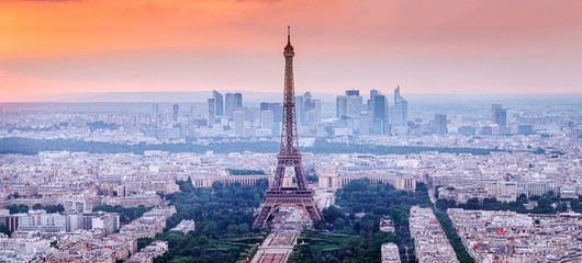FototapetaParis, France. Panoramic view of Paris skyline with Eiffel Tower in the center. Amazing sunset scenery with dramatic sky.