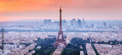 Poster Paris Paris, France. Panoramic view of Paris skyline with Eiffel Tower in the center. Amazing sunset scenery with dramatic sky.