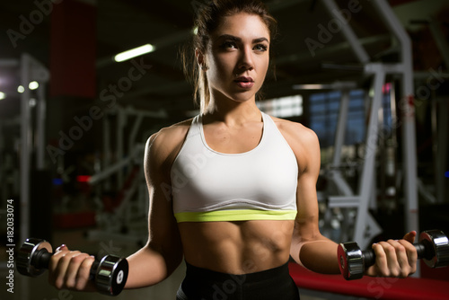 Keuken foto achterwand Ontspanning A girl trains in the gym.