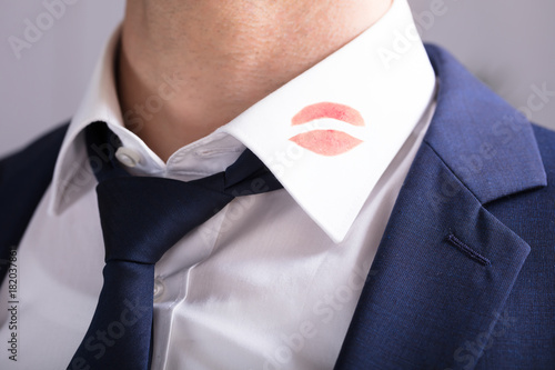 Leinwand Poster Businessman With Lipstick Kiss Marks On Shirt's Collar