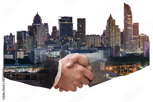 The double exposure image of the business man handshaking with another one during sunrise overlay with cityscape image Canvas Print