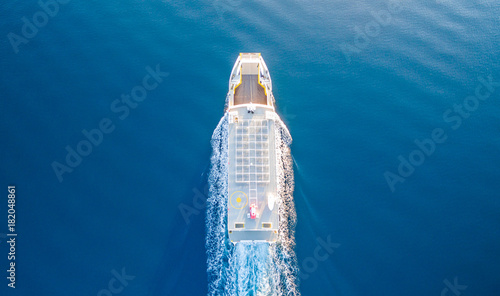 Fototapeta CORFU, GREECE- NOVEMBER 24, 2017: A ferry of the Lefkimmi Lines in Corfu Greece crossing opposite Corfu island towards Greece mainland
