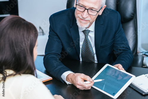 Woman meeting financial adviser in office Canvas Print