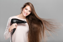 Woman Drying Her Hair With Dry...