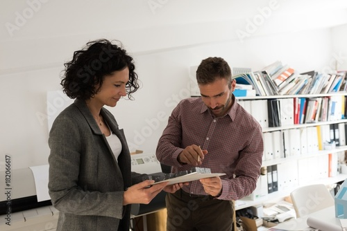 Male and female architects working together