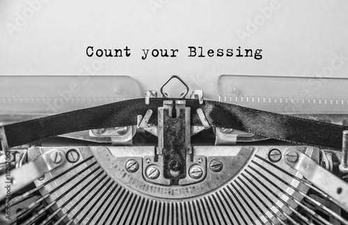 Stampa su Tela Vintage old typewriter on white background with text Count your Blessing