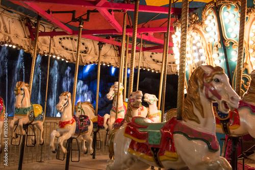 Fotografie, Obraz  Park horse carousel ride, ferris wheel kids old attraction