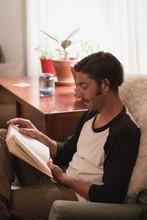 Man Reading A Novel In Living ...