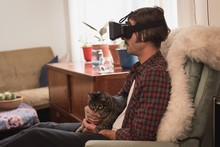 Man With His Cat Using Virtual...