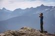 Male hiker looking through binoculars