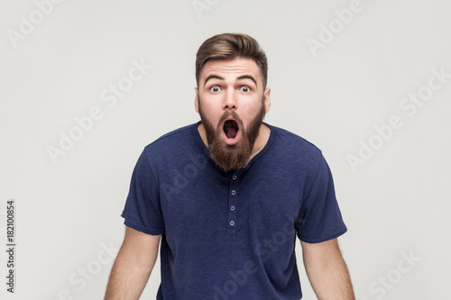Fotografie, Obraz  Unbelievable news! Young adult man open mouth and shocked