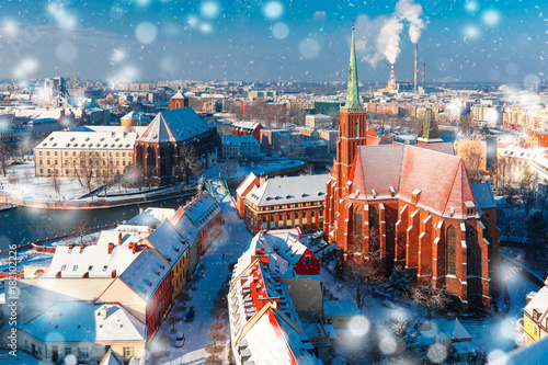 Aerial view of Ostrow Tumski with church of the Holy Cross and St. Bartholomew from Cathedral of St. John in the winter snowy morning in Wroclaw, Poland