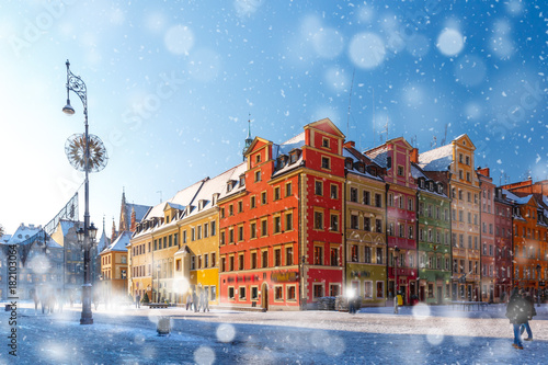 Multicolored traditional historical houses on Market square in the winter snowy morning, Old Town of Wroclaw, Poland