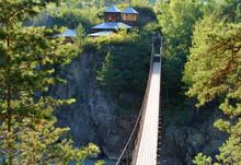 Suspension Bridge To Island Of Patmos. Chemal, Altai Republic, Russia