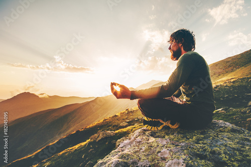 Poster Ecole de Yoga Man meditating yoga lotus pose at sunset mountains Travel Lifestyle relaxation emotional concept summer vacations outdoor harmony with nature calm scene