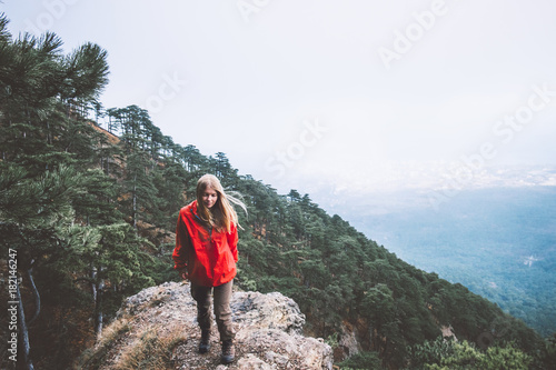 Printed kitchen splashbacks Khaki Woman Traveler walking on mountains cliff alone aerial view forest on background Travel Lifestyle adventure vacations concept