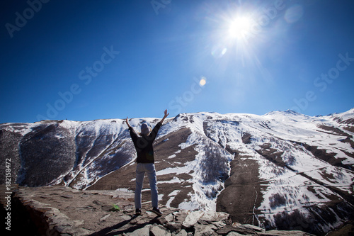 Photo Stands Mountaineering Tourist in the mountains
