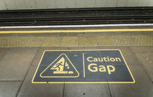 Mind The Gap Sign On Edge Of P...