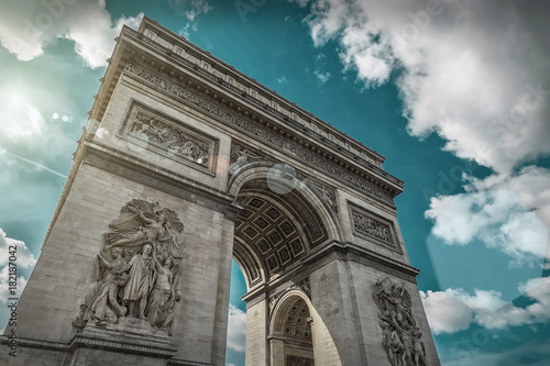 Valokuva  Arc de Triomphe in Paris under sky with clouds. One of symbols o