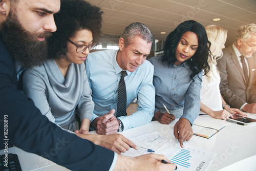 Photo  Contemporary multiracial team working on project in office