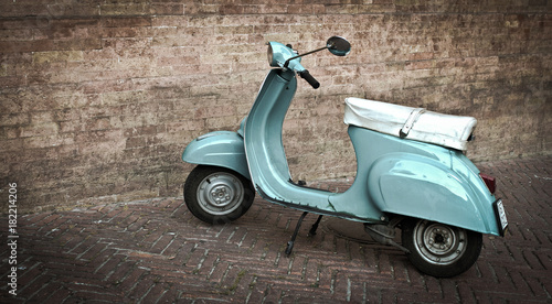 Fotobehang Scooter Tourqoise Vespa, Italy, Brick wall