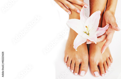 In de dag Pedicure manicure pedicure with flower lily close up isolated on white