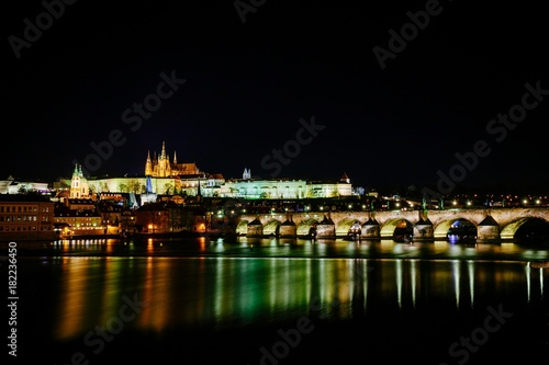 The view from the river Vltava at Charles Bridge and Prague Castle at night Wallpaper Mural