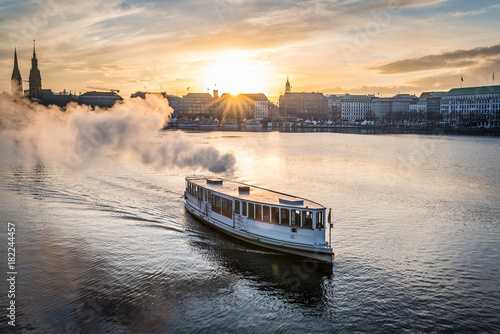 steamboat on Alster Lake in Hamburg, Germany with cityscape in background during Canvas-taulu