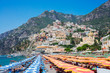 Sea and row of umbrellas on beach of Positano - famous old italian resort, Italy