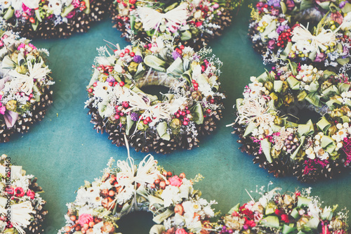 Fototapety, obrazy: Christmas flowers wreaths decorations in Cracow Christmas market in Poland.