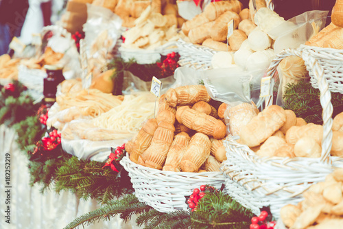 Traditional polish smoked cheese oscypek on Christmas market in Cracow, Poland.