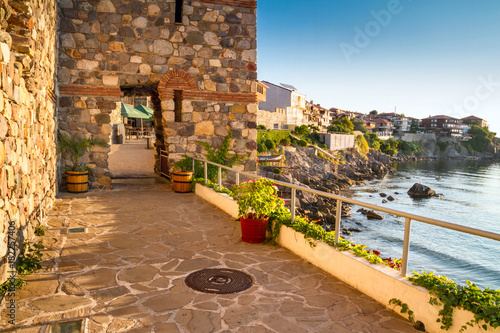 Foto auf Leinwand Stadt am Wasser Seaside landscape - fortress wall and tower in the city of Sozopol on the Black Sea coast in Bulgaria