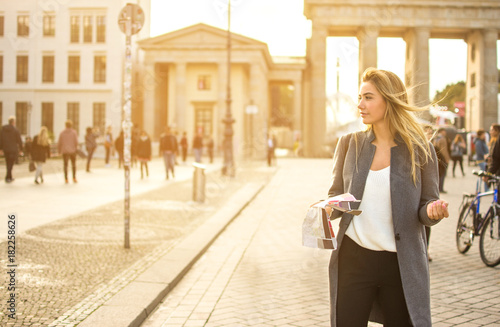 Young woman with a city map searching attraction outdoors.