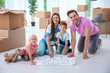 Happy family with house plan on floor indoors