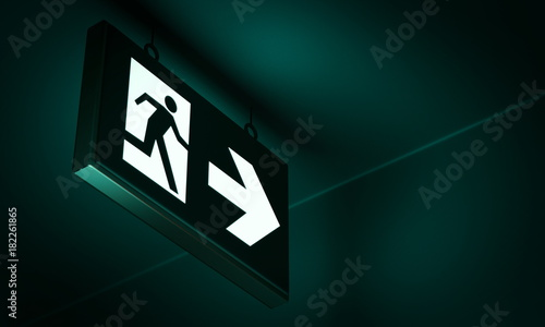 Foto Emergency exit sign in corridor point way out of building - 3d render