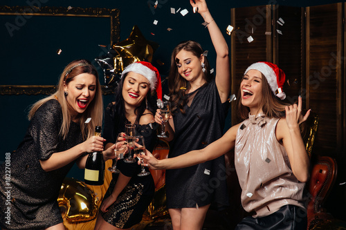 Fotografie, Obraz  Women have fun at Christmas party