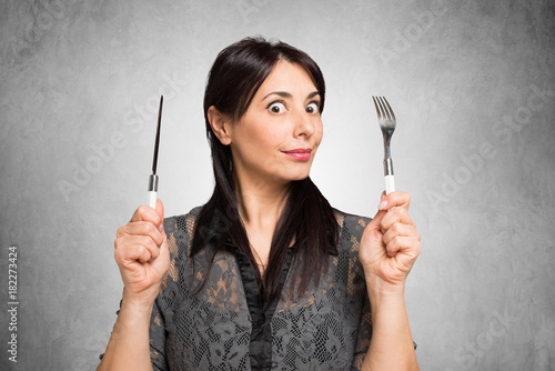 Fotomural Hungry woman holding fork and knife