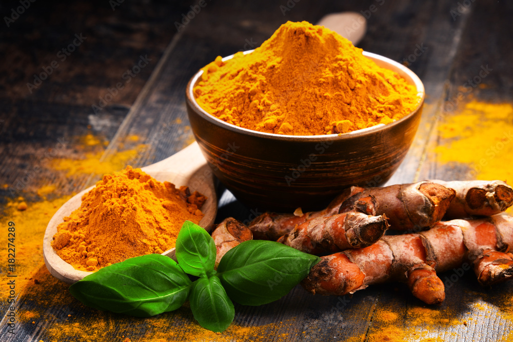 Fototapety, obrazy: Composition with bowl of turmeric powder on wooden table