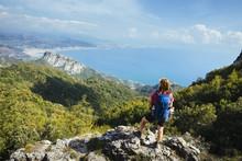 Female Hiker With Daypack On The Amalfi Coastal Trail / Salerno, Italy, Europe