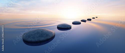 Fotografia  Steine im See bei Sonnenuntergang