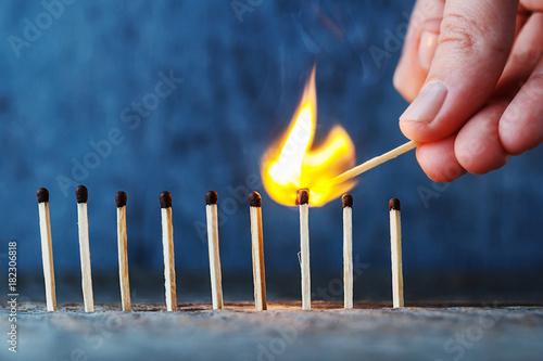 Photo lit match fires another match