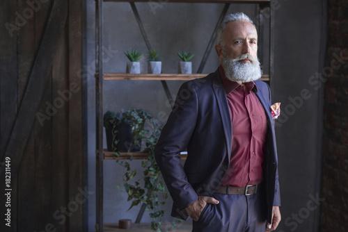 Fotografie, Obraz  Portrait of serene unshaven old businessman situating in apartment